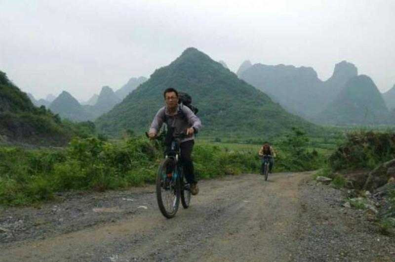 绿色骑行 安全用电进瑶乡--人民网广西频道--人民网