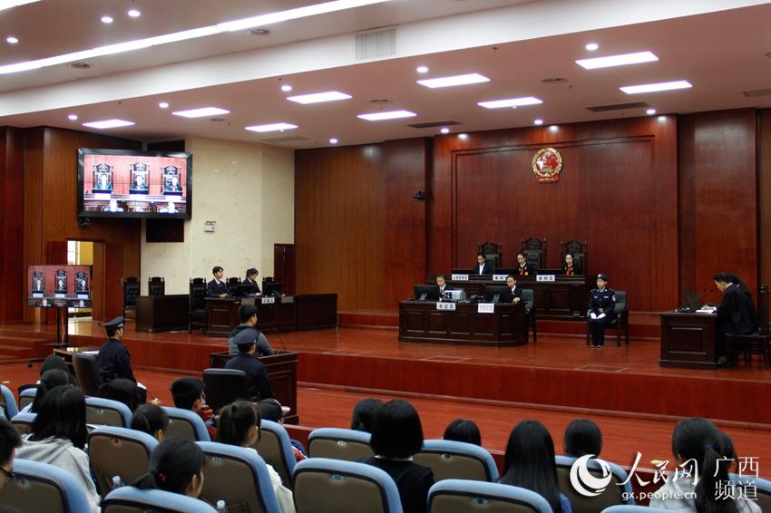广西高院邀请广西民族大学法学院、广?-国家宪法日 广西 大学生模拟
