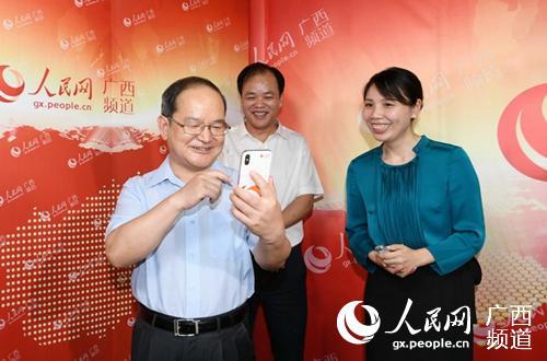 """专家点赞广西党政干部走""""网上群众路线"""":以真心换民心"""